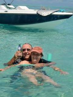 swimming while enjoying a mauritian beer