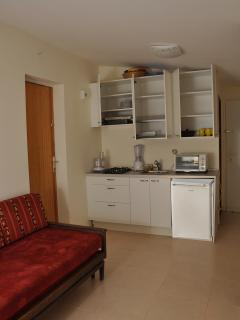 Kitchenette with open cupboard doors