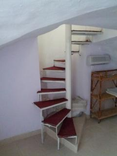 stairs to bedroom/up to living room
