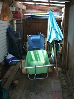 Storage shed with everything you need for the beach, including a Wheeleez cart to carry beach items!