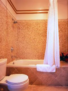 Beautiful tile in this second floor Jacuzzi tub bathroom