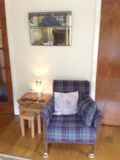 Scottish tartan armchair with Charles Rennie McIntosh morror above