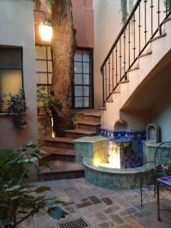 The fountain in the central courtyard & stairs leading to Casita Opal's Loggia