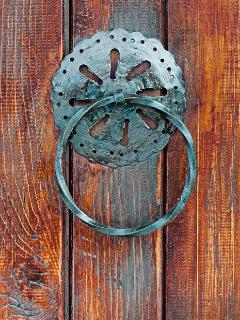 Zvekir (door-knocker) on our entry door. It only serves aesthetic purpose.