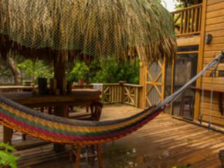 Relax in one of 10 Hammocks around the property