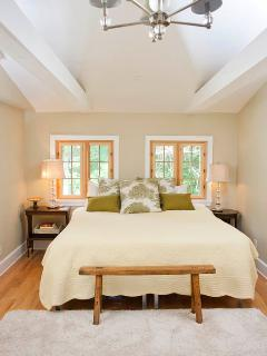 High ceilings and lots of light give the bedroom a spacious feel.