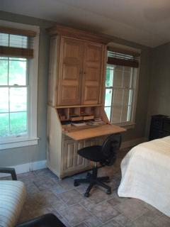Let this hand built maple wood secretary stocked with maps and brochures be your command central.