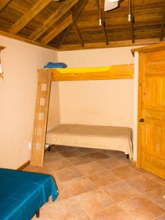 Queen bed and a loft bed or 2 twins with the loft. Divers love it here