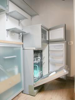 Large fridge with a roomy separate freezer section and dishwasher.