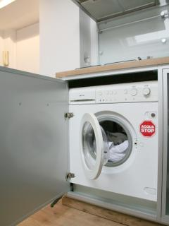 The kitchen also includes a washer/dryer for your convenience