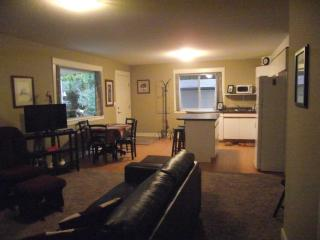 Open Concept Living/dining/kitchen with full size dishewasher, stove and fridge and Leather sofa too