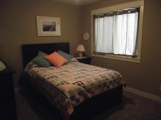 Bedroom #2 has new double mattress with metal frame, home made quilt and tastefully decorated.