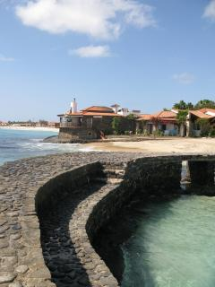 View from the old port wall past the private beach to the east and the main beach