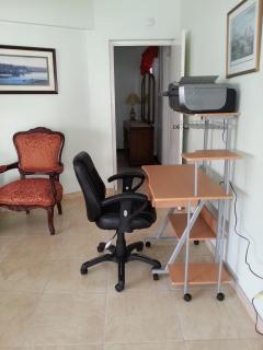 Computer desk and multifunction printer.