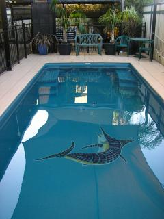 poolside Suites sail shaded, Solar heated, pool with bubble spa seats