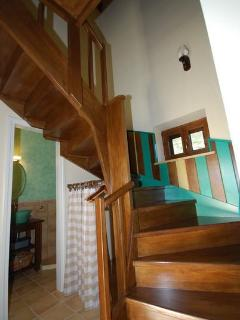 Wooden staircase leading to the bedroom