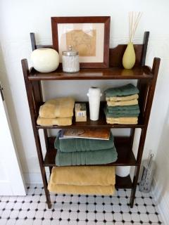 The towel stand in a guest bathroom.