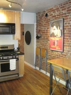Contemporary kitchen combined with 1890s brick!
