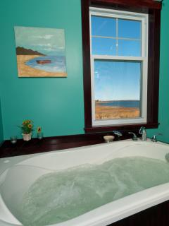 Washroom upstairs with air tub to relax in after a long day