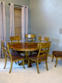 Dining room table seats 6. Large round table is a great place for board games.