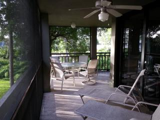 Roomy wrap-around lanai is furnished for dining and lounging