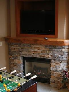 Downstairs great room has toasty warm fireplace, LED Flat Screen TV with Blu-Ray and DVD player, and a tournament ...