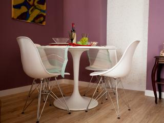WhiteTulip design dining table  with Eiffel Eames chairs