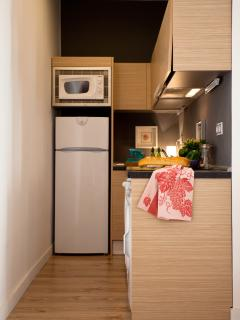 Full equipped kitchen, refrigerator / freezer, ceramic hob (stove), dishwasher and washing machine.