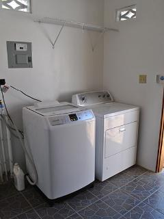 Shared Laundry Room at Latitude Adjustment in Hopkins Belize