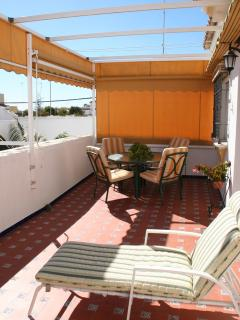 Extensive private terrace (30m2), very sunny (south facing) with awning and garden furniture.