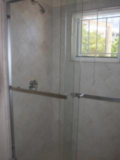 Both bathrooms have glass shower cubicles