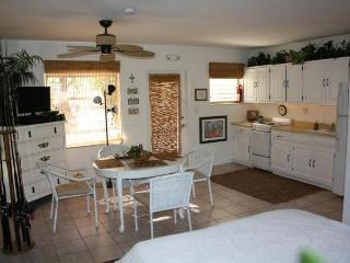 Unit 10, Kitchen  and living/dining area with 4 chairs