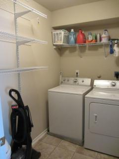 Utility Room w/ washer and dryer