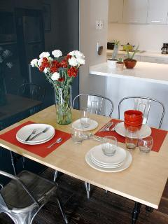 The dining area for 4 people is perfectly placed in between the open kitchen and the living room.