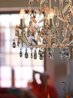 Old world chandelier above the dining table