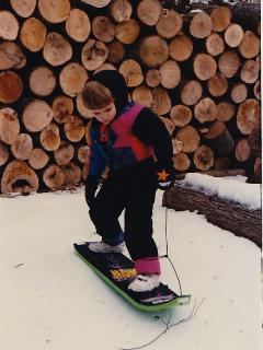 little guy grew up to be on national crew team hung up the snowboard