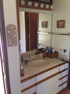 vanity with glass closet doors