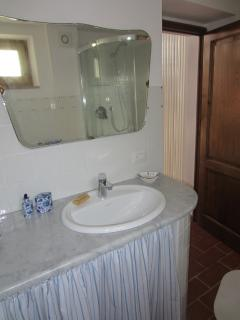 the bath room: old fashion marble and mirror