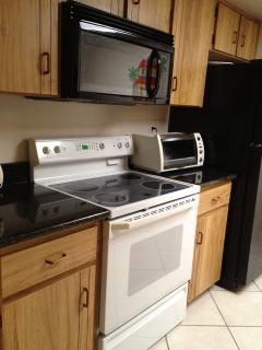 Kitchen With full size appliances  Stove, oven, microwave, fridge, dishwasher, toaster oven, Keurig