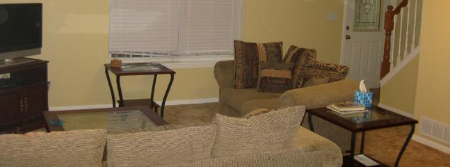 Enjoy lounging around in the living room area. We offer Dish Network channels for our guests.