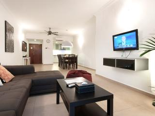 Open-plan living/dining space with cable TV