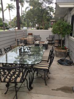 patio with table for six, bbq, and fire pit