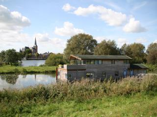 Houseboat on the river IJssel near city of Kampen