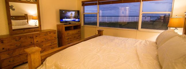 Master bedroom with king bed, oceanfront views and new 40' HD LED plasma TV