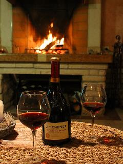 Glass of wine by the fireplace