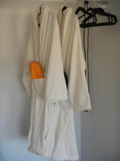 Comfortable robes and slippers are provided.