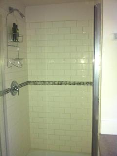 New 3-piece bath with tiled shower