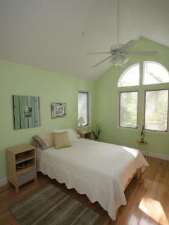 Queen size bedroom with flat screen