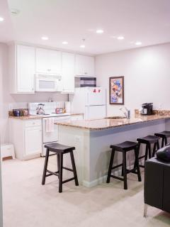 Kitchen with large  counter for bar style dining