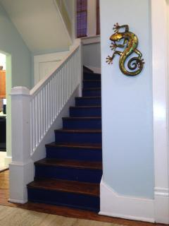 Large stair case leading to upstairs bedrooms.